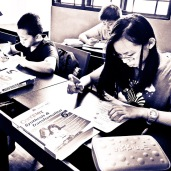 Primary English class in small group format.