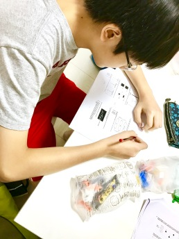 Primary 5 Science Punggol Tuition lesson doing MCQ and getting A* scores by practicing Science