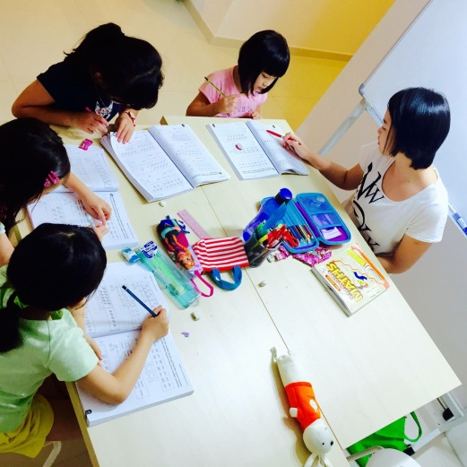 Tutor Yuet Ling makes sure all students understand what is being taught.