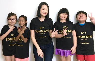 Tutor Yuet Ling with Primary Students and our Semester 2017 T Shirts.